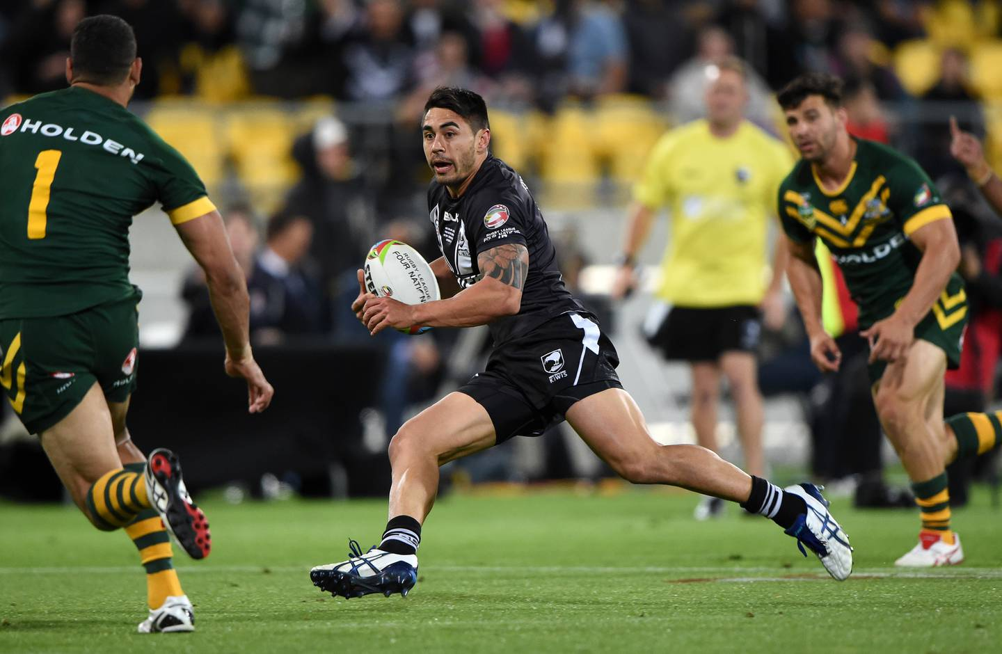 Shaun Johnson makes a break on his way to the try line during the 2014 New Zealand Kiwis and Australia Kangaroos Four Nations Rugby League final in Wellington. Wellington, New Zealand. Saturday 15 November 2014. Photo: Andrew Cornaga / www.Photosport.co.nz