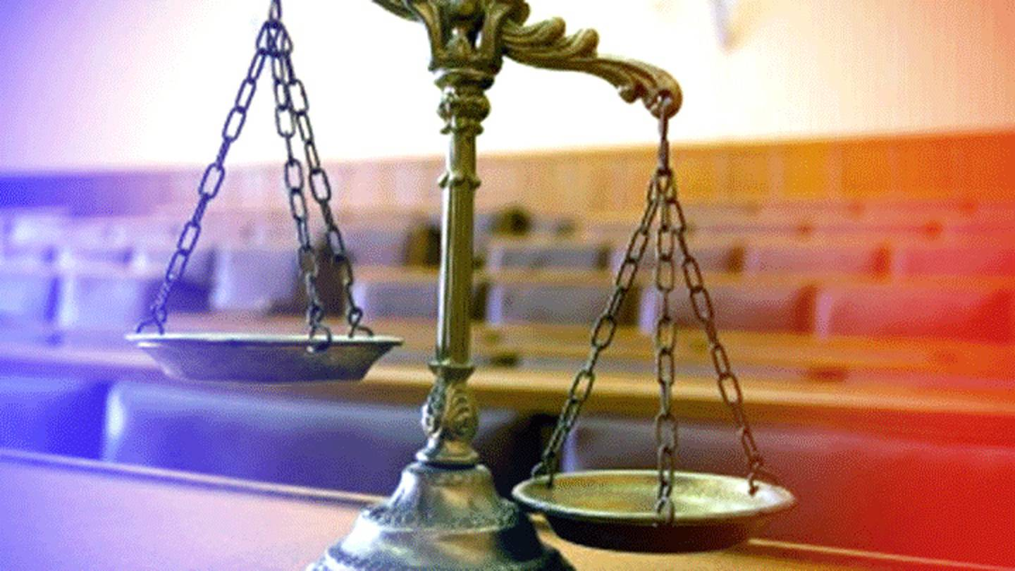 A file image of a set of scales in a courtroom.