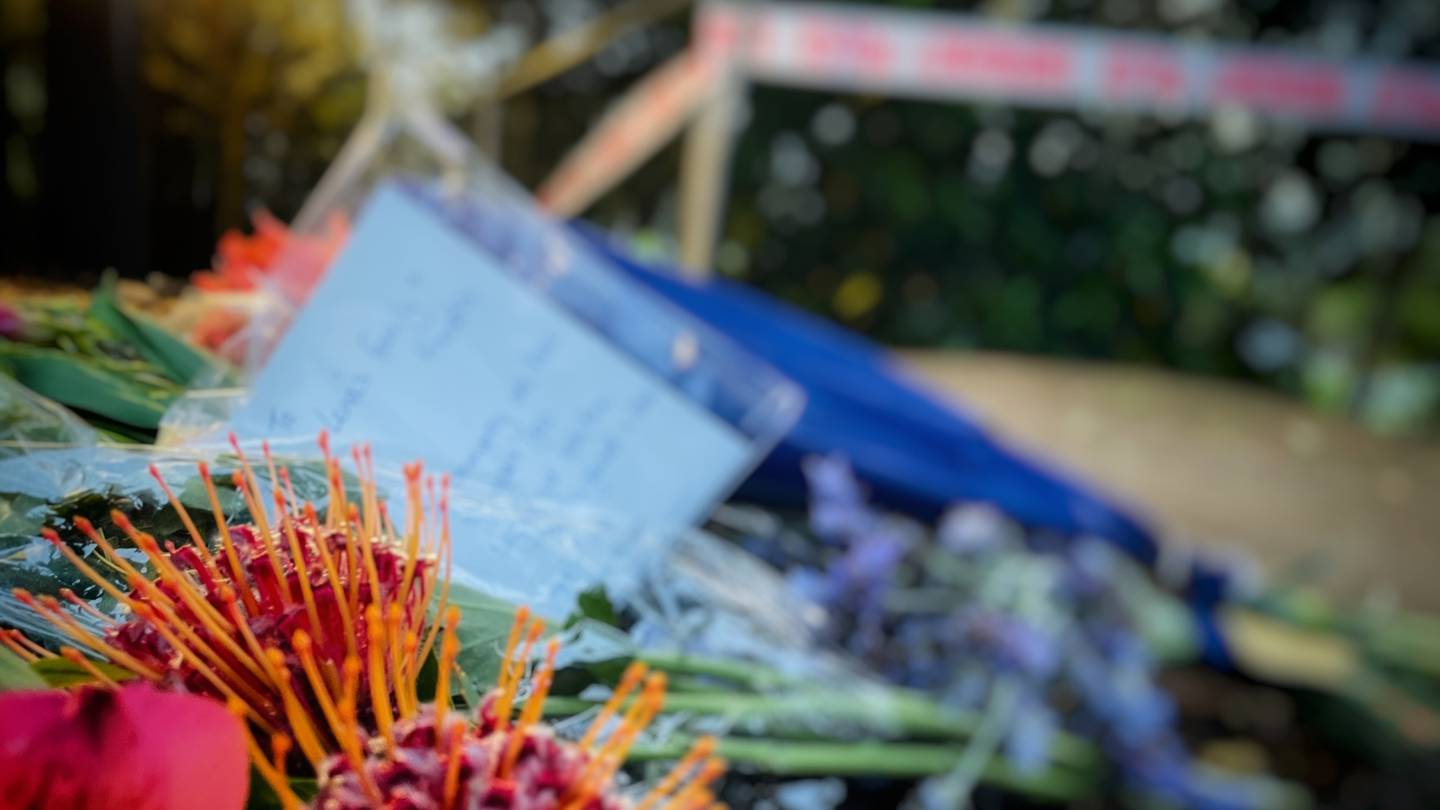 Flowers laid near where Lena Zhang Harrap was found at a walkway in Mt Albert.