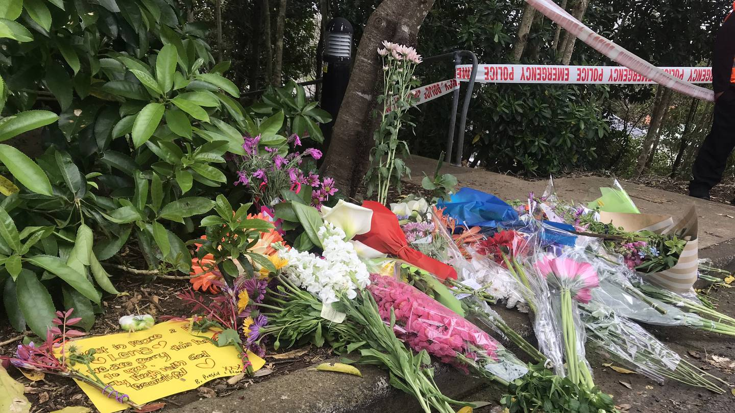 Flowers and messages laid near where Lena Zhang Harrap was found at a walkway in Mt Albert.
