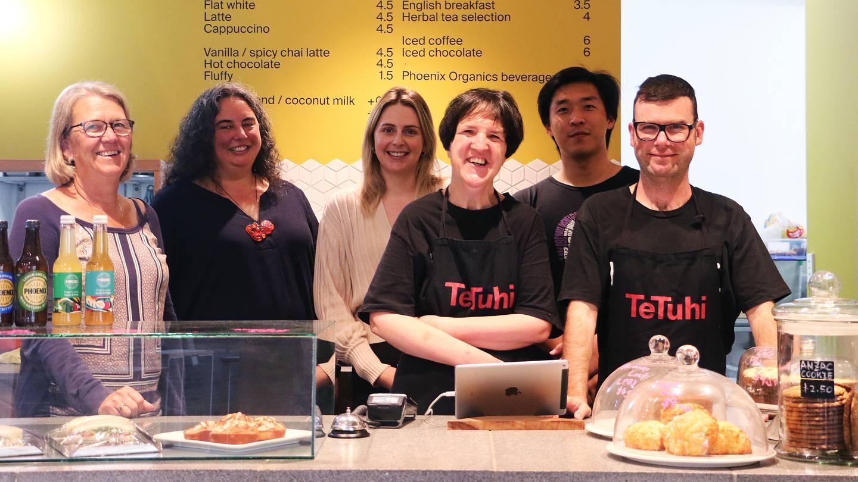 Te Tuhi's Cherry Tawhai and Hiraani Himona, support staff Emily Searle, trainee Rachel Martin, café manager Jimmy Zhao, and trainee Tom Russell at Te Tuhi Café in Auckland, Pakuranga.