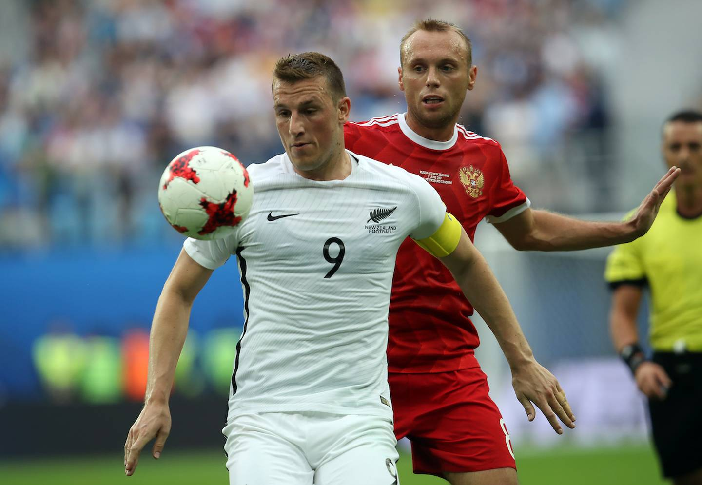 All Whites Chris Wood up against Russia's Denis Glushakov. FIFA Confederations Cup Russia 2017, Russia v New Zealand, Saint Petersburg Stadium Russia, Saturday 17th June 2017. Copyright photo: Shane Wenzlick / www.photosport.nz