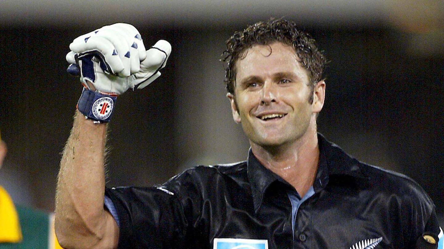 Man of the Match Chris Cairns celebrates scoring the winning runs in the 50th over during the tri series ODI cricket match between the New Zealand Black Caps and South Africa, 19 January 2002, Gabba, Brisbane, Australia. Photo: Andrew Cornaga/PHOTOSPORT    044703