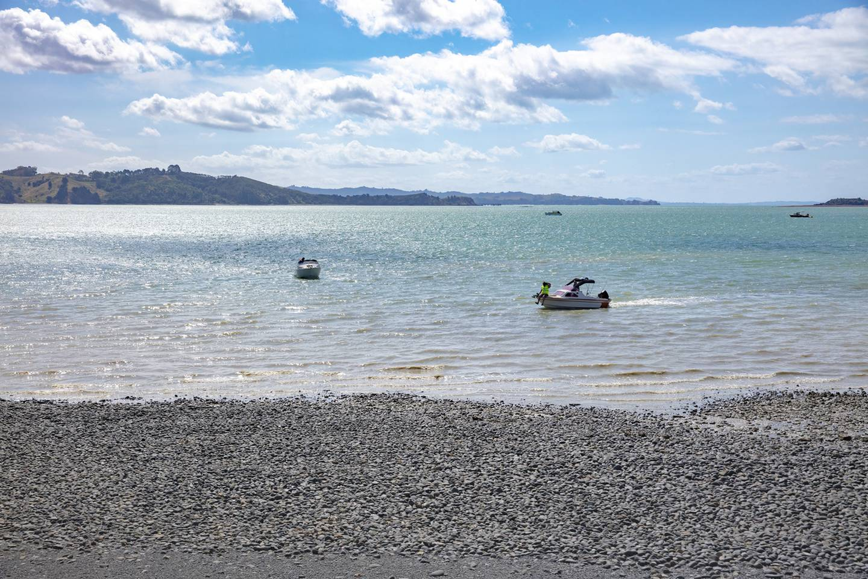 Boats at low tide of Kawakawa Bay Beach, New Zealand in summer.