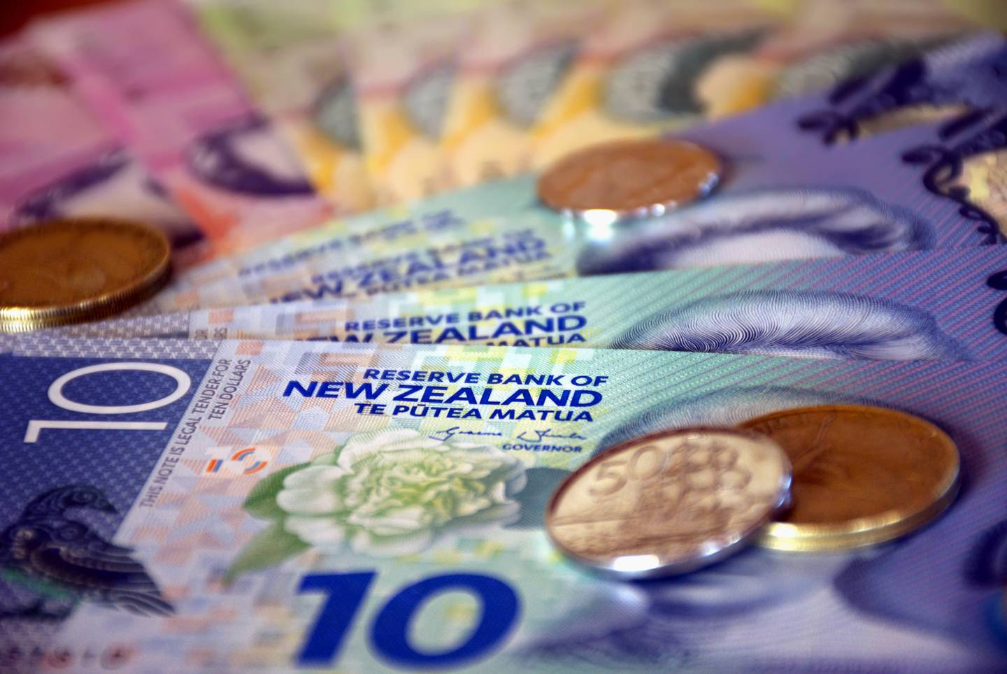 A mixture of New Zealand Bank notes and coins.