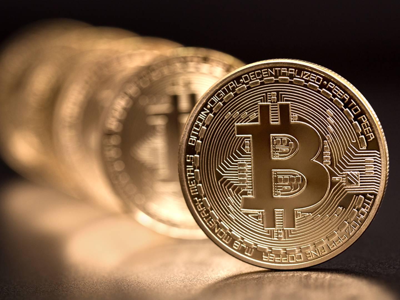 Sofia, Bulgaria - April 24, 2014: Studio shot of  bitcoin in a row on black background . Bitcoin - bit coin BTC the new virtual money