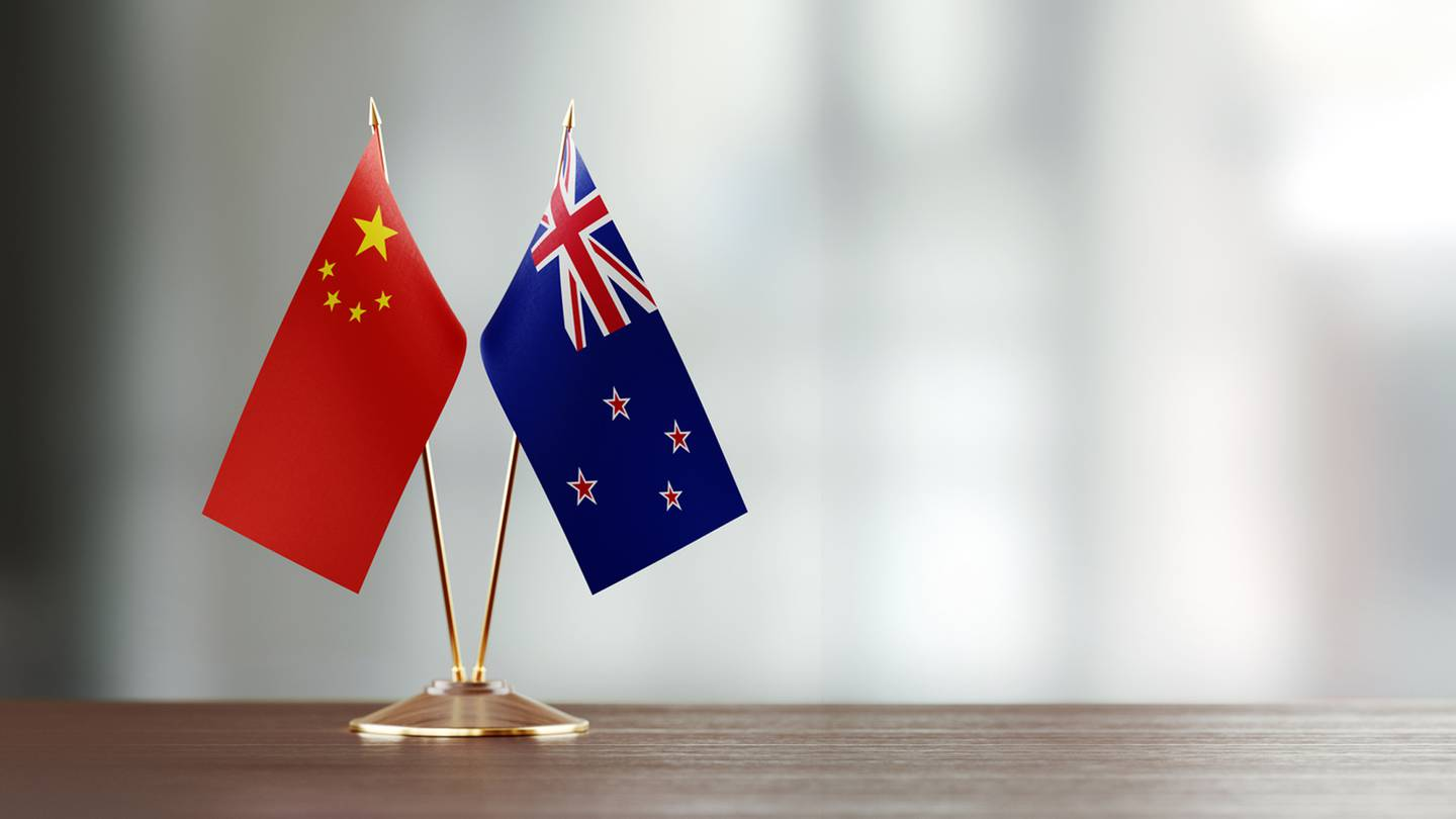 New Zealand and China's flags.