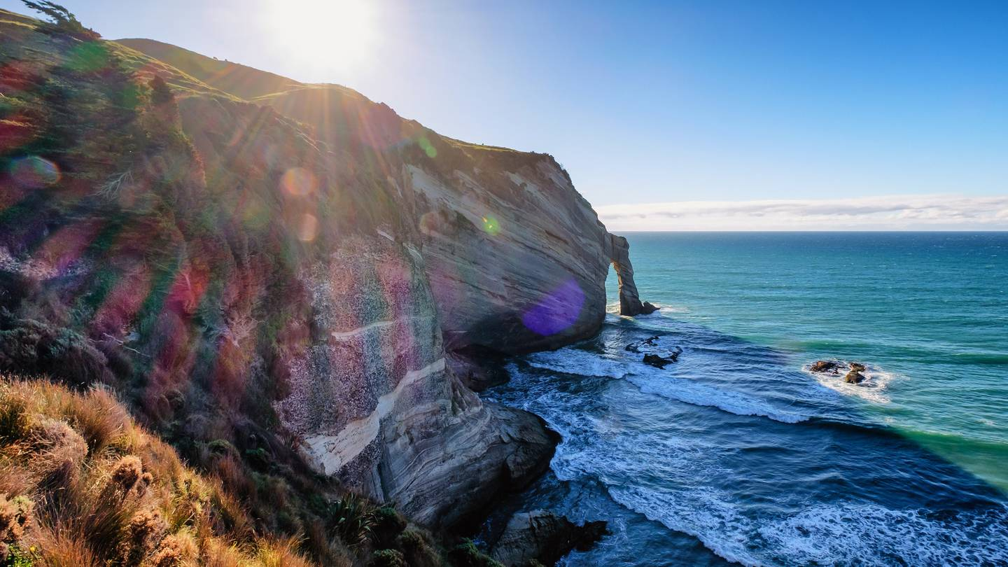 A spectacular rugged coastline at Cape Farewell in New Zealand. Steep drop offs, rock formation and panoramic views, this coastal attraction provides visitors a breathtaking experience.